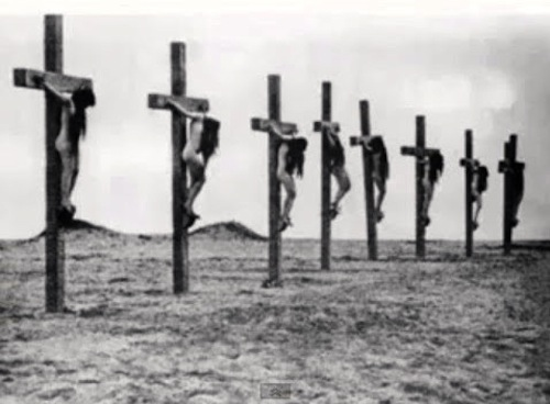 Crucified Armenian Christian women in the open-air concentration camp of the Der-es-Zor in the Syrian desert in 1915