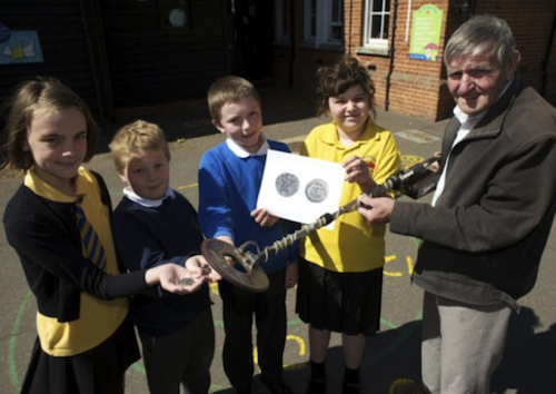 Hoxne, Suffolk—Eric Lawes who found the Hoxne Hoard shows some children at St Edmunds Primary School how he found it with a metal detector.