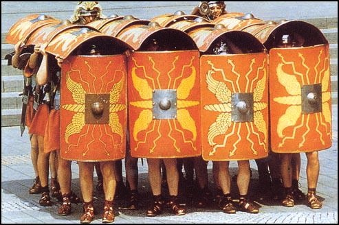 Modern reenactment of Roman soldiers in the testudo (tortoise) formation
