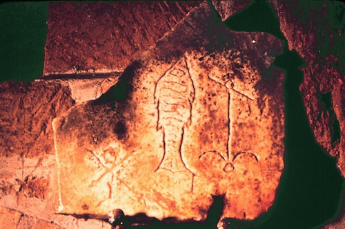 Three early Christian symbols, the fish, the anchor and the Chi Rho, depicted together in the Catacomb of St. Sebastian, Rome