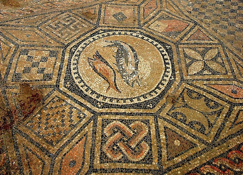A mosaic on the floor shows two large fish, the Ichthus symbol.