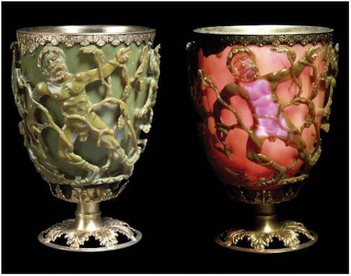 The Lycurgus Cup with light from both sides. The rim is mounted with a silver-gilt band of leaf ornament. Its silver-gilt foot has open-work vine leaves—British Museum